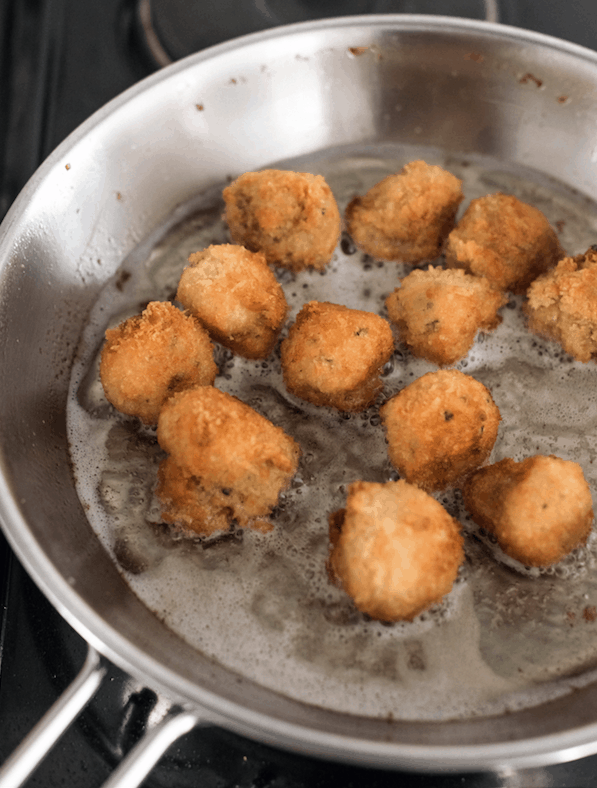 panko crusted mushrooms in the pan while frying