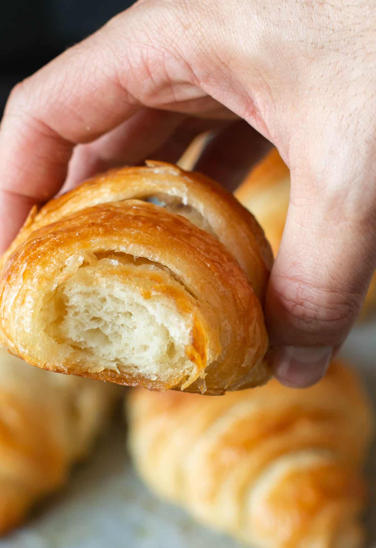 Image of a croissant with a bite in it