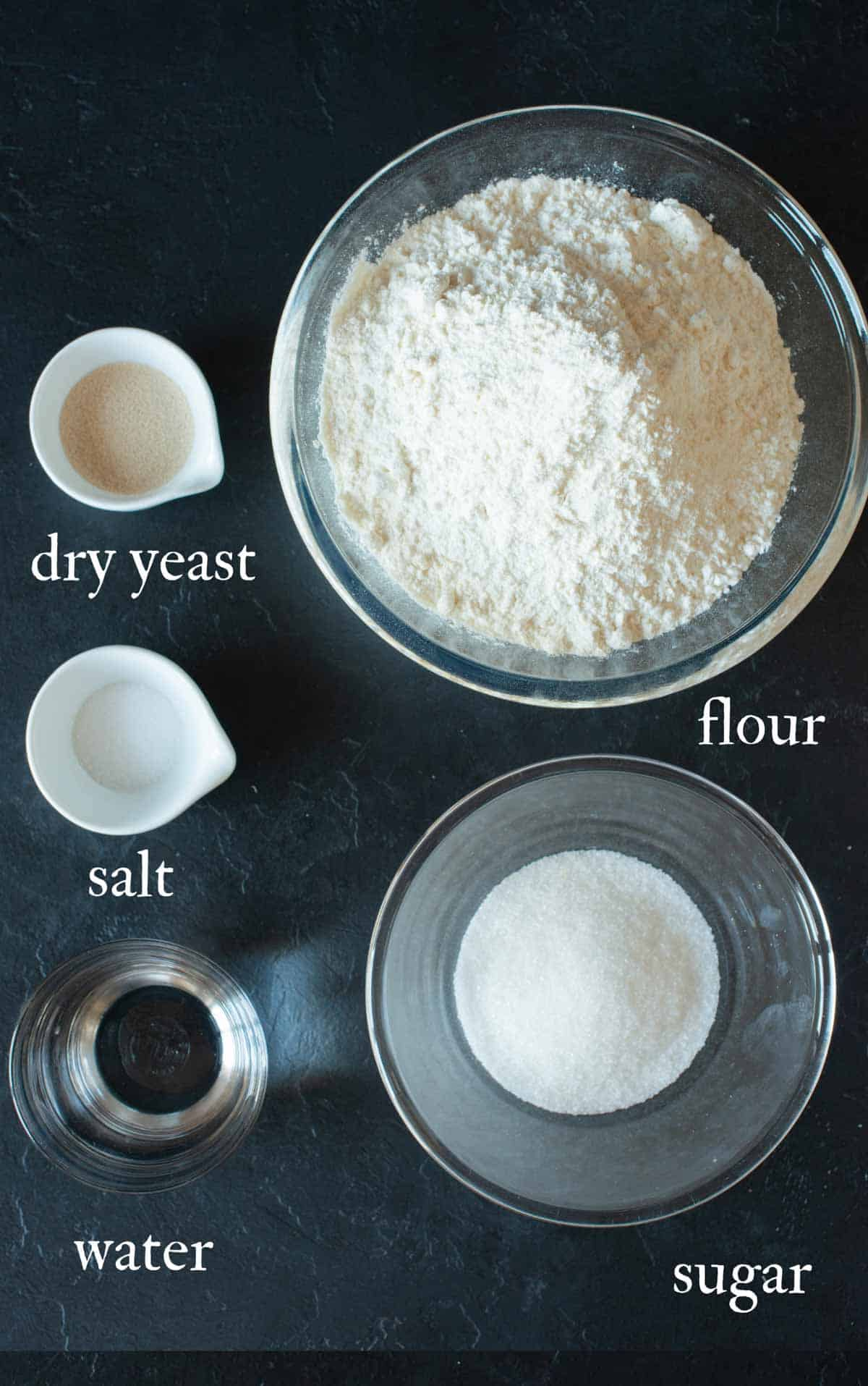 Image of  the ingredients needed for the croissants: yeast, flour, water, salt and sugar.